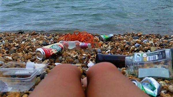 Environmentalists go naked to strip Brighton beach of rubbish
