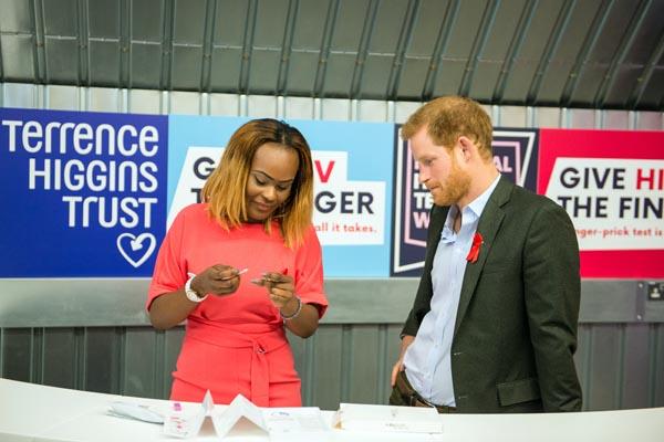Prince Harry attends THT HIV pop-up shop