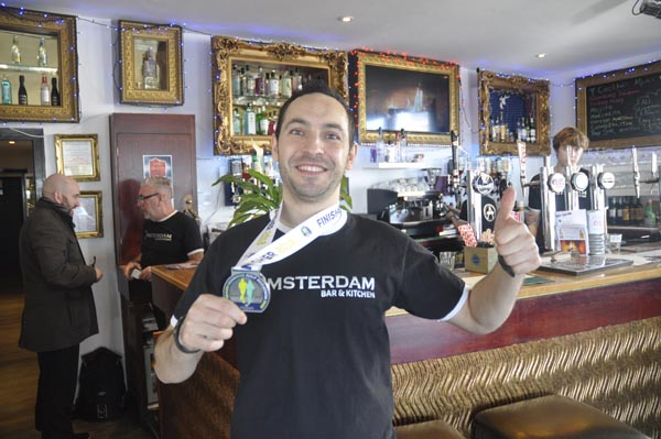 Amsterdam manager raises more than £700 for Sussex Beacon