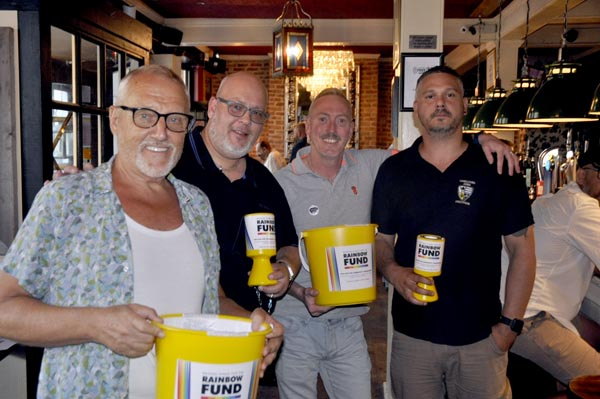 Pictured left to right: Chris Gull Chair of Rainbow Fund, Chris Stringer, Danny Dwyer and Ben Williams manager of the Camelford Arms