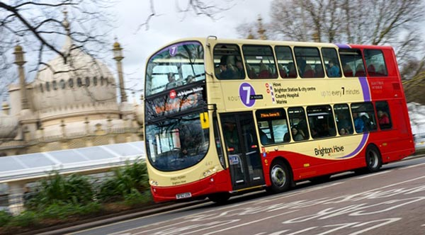 Youths risk injury riding illegally on the back of Brighton & Hovebuses