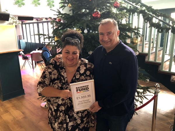 Rainbow Fund grants panellist Maria Baker hands Revenge General Manager Andrew Roberts a certificate to mark their World Aids Day fundraising in December 2018