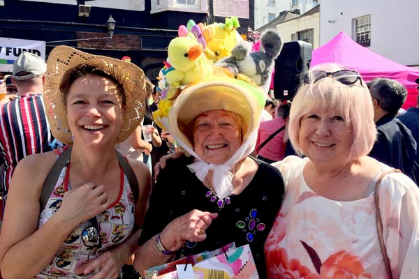 Kathy Caton (judge), Grace (Easter Bonnet Parade winner) and Carole Todd (judge)