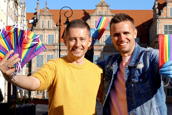 Gay Couple hand out Rainbow Masks on the Streets of Poland